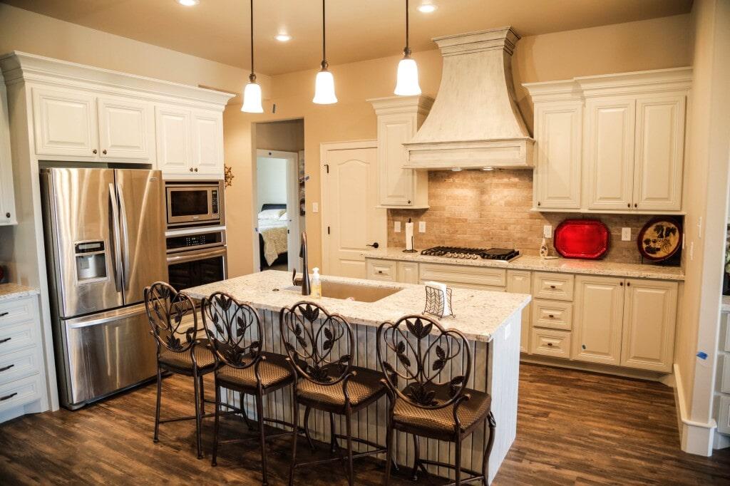 Kitchen remodel with luxury vinyl plank (LVP) flooring and custom tile backsplash by Yates Flooring Center (2)
