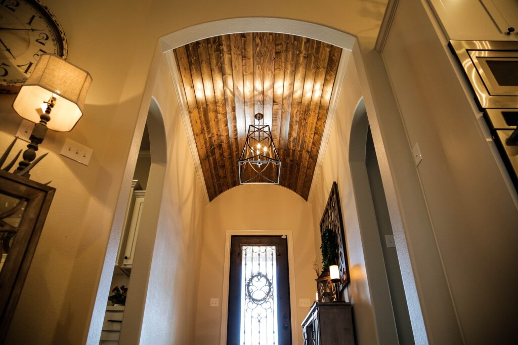Front entryway with unique hardwood ceiling feature by Yates Flooring Center