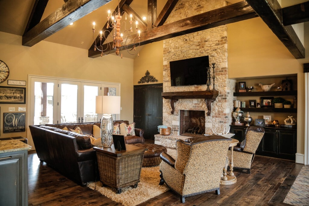 Rustic open concept living space with hardwood flooring by Yates Flooring Center