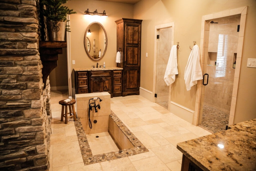 Spa-like bathroom retreat with custom tile and natural stone elements by Yates Flooring Center