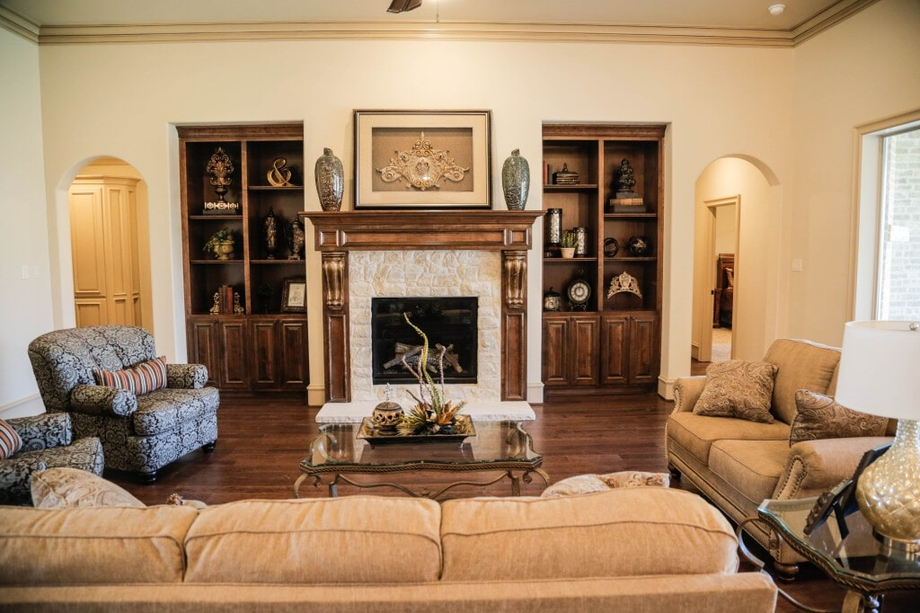 Traditional living room with hardwood flooring by Yates Flooring Center