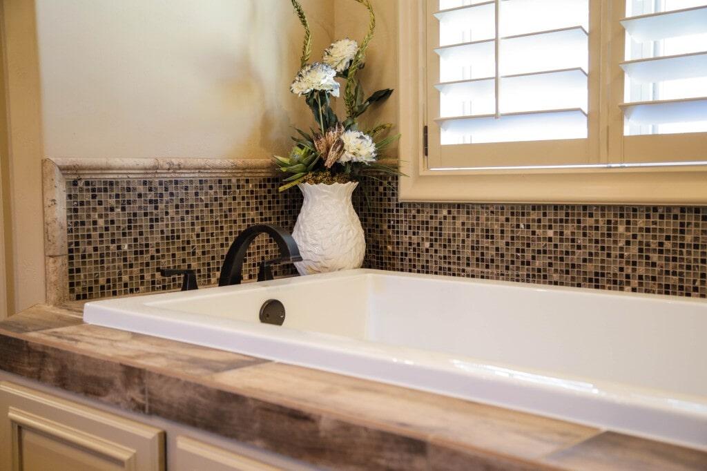 Glass tile tub backsplash by Yates Flooring Center