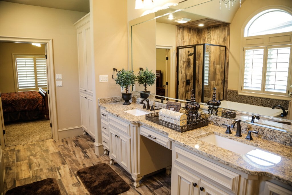 Custom bathroom with gorgeous tile shower, floors and glass tile mosaic backsplash along the tub by Yates Flooring Center (2)
