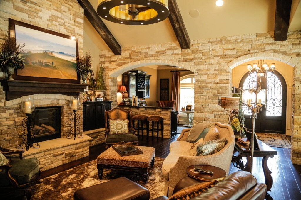 Traditional meets rustic with natural stone and hardwood flooring throughout by Yates Flooring Center