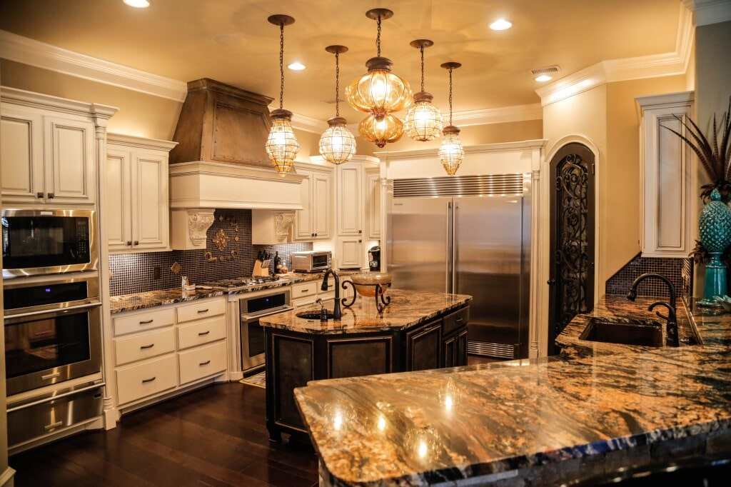 Traditional kitchen with hardwood flooring by Yates Flooring Center