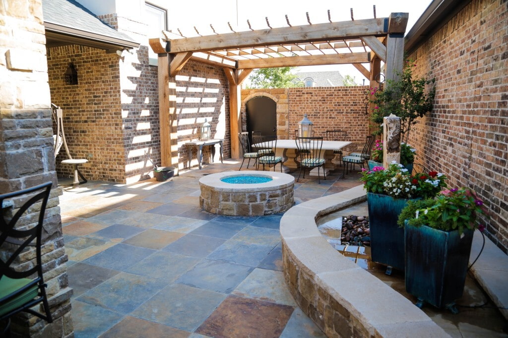 Natural stone courtyard with slate flooring and flagstone features by Yates Flooring Center