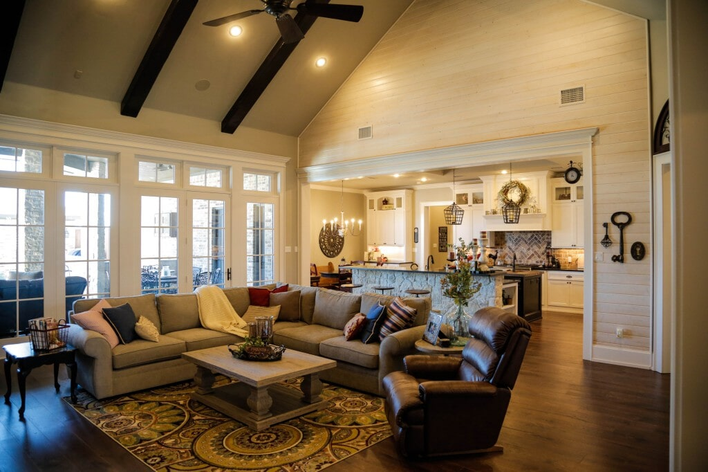 Modern farmhouse open concept living room and kitchen with hardwood flooring by Yates Flooring Center