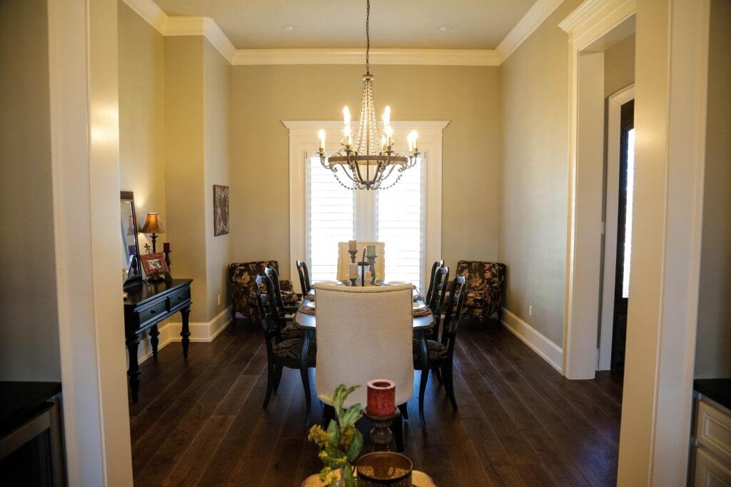 Traditional dining room with dark hardwood flooring by Yates Flooring Center