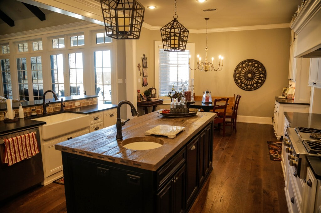 Modern farmhouse kitchen with rustic reclaimed wood flooring planks by Yates Flooring Center