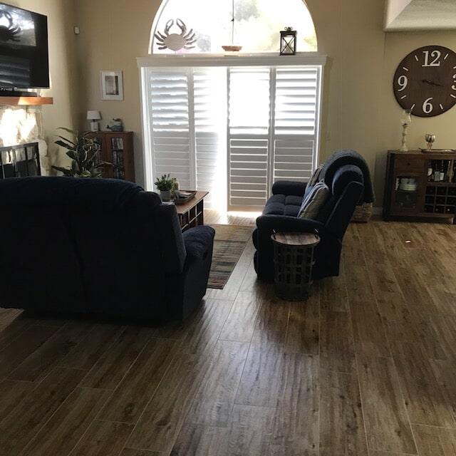 Livingroom flooring installation of carpets and hardwoods