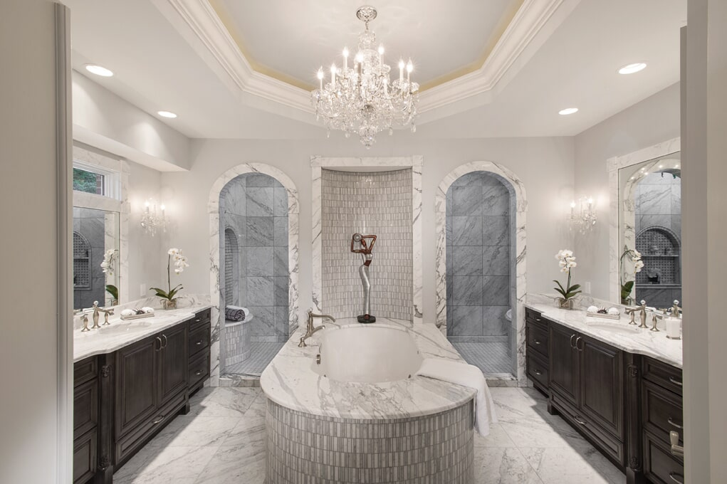 This 270-square-foot master bathroom is lavish with a blend of marble coverings.