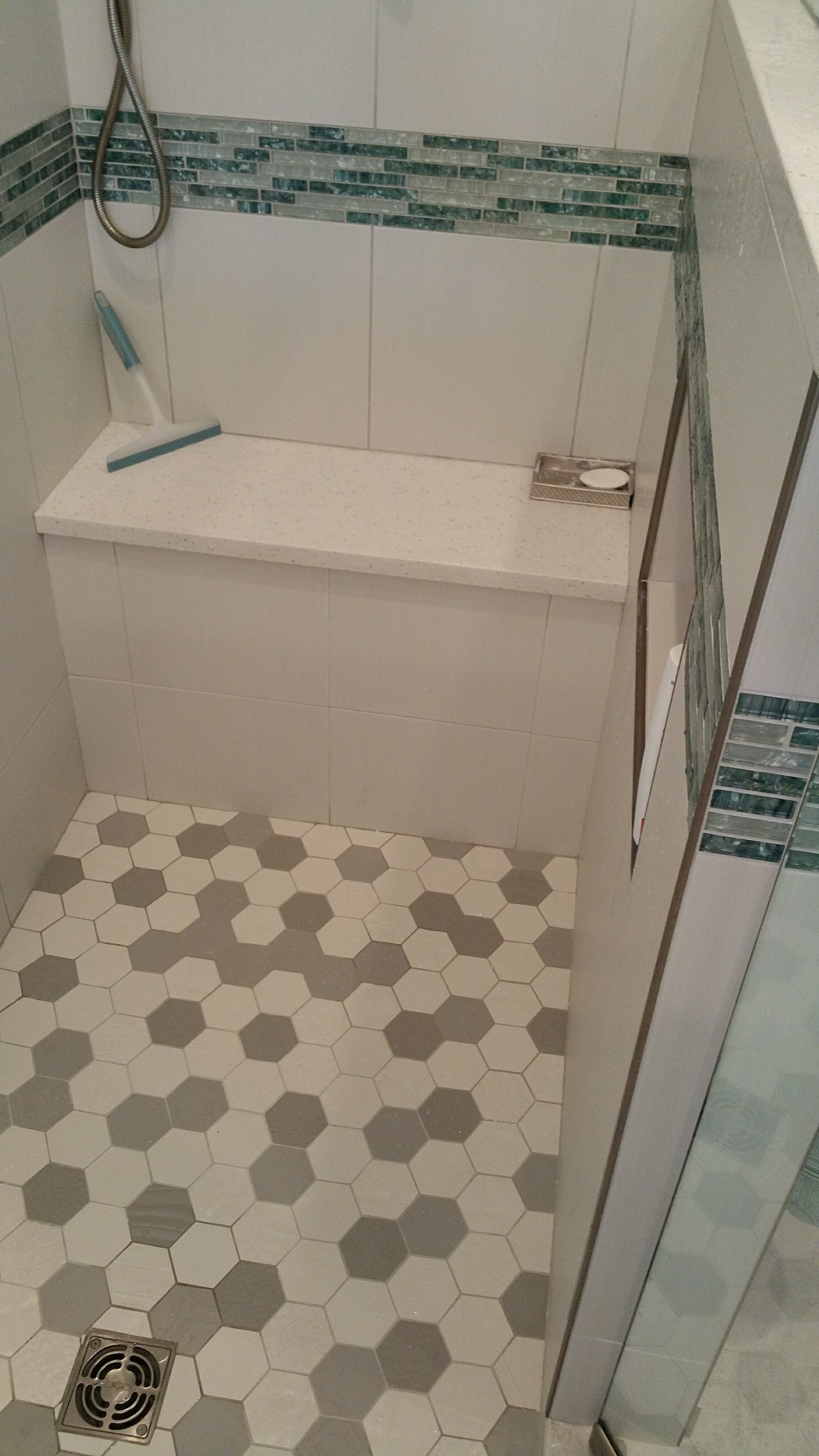 Aqua tile with decorative listello and shower bench - Relo Interior Services