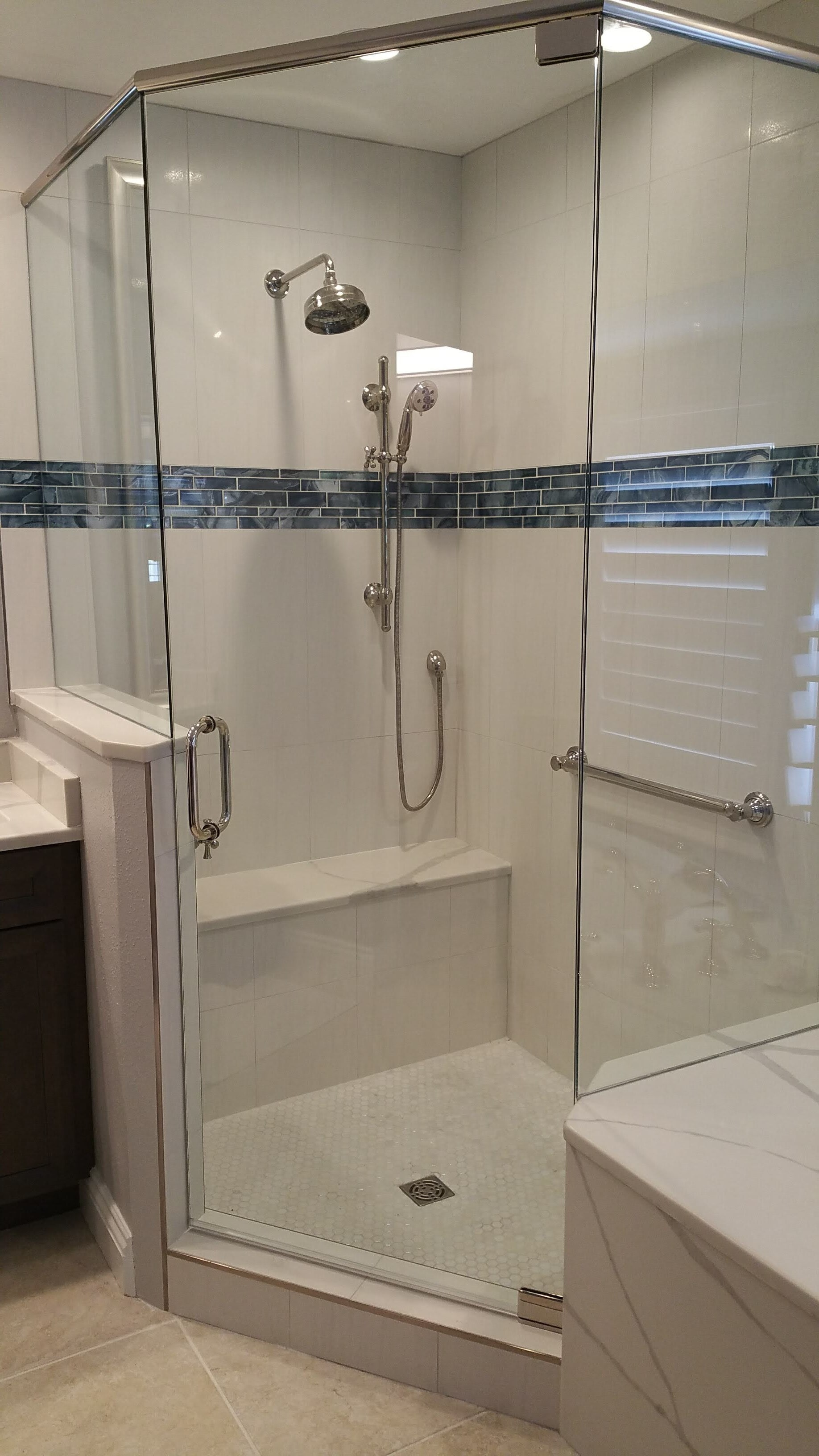 Corner Shower tile and full remodel from Relo Interior Services