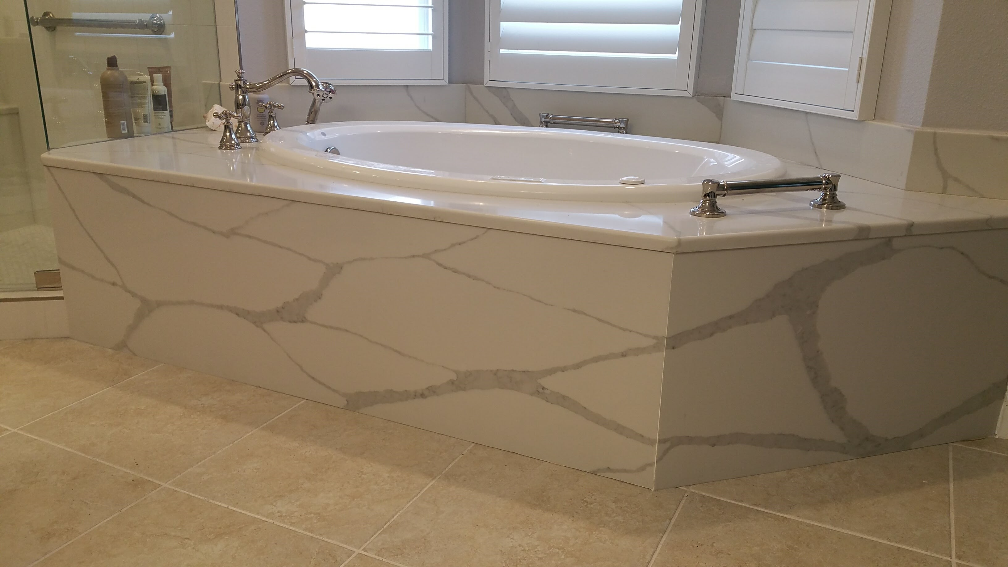 Relo Interior Services remodel with Coastal Bathroom theme and whirlpool tub