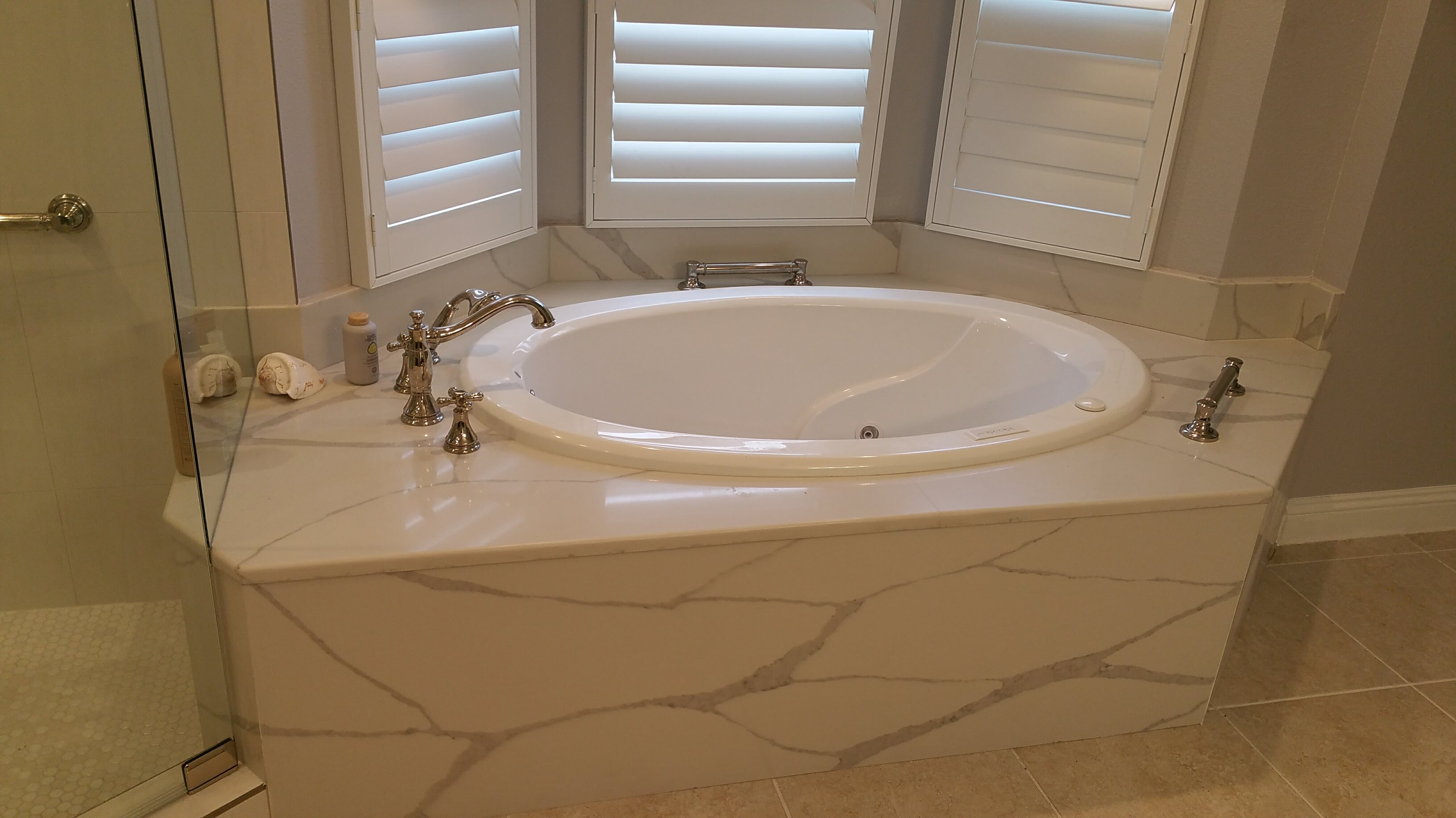 Whirlpool tub with quartz tub deck from Relo Interior Services