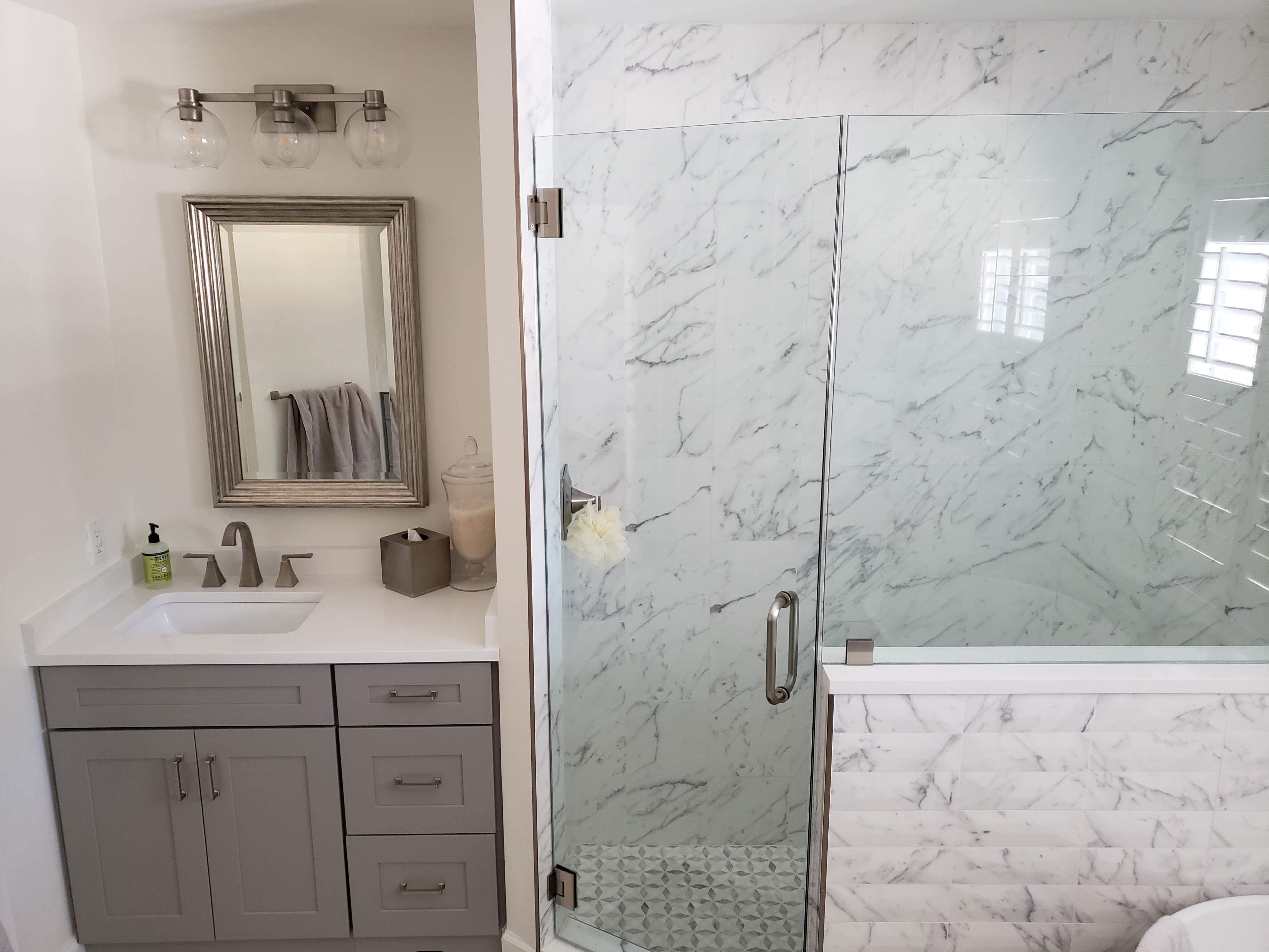 Frame-less walk-in shower installation from Relo Interiors Serivces