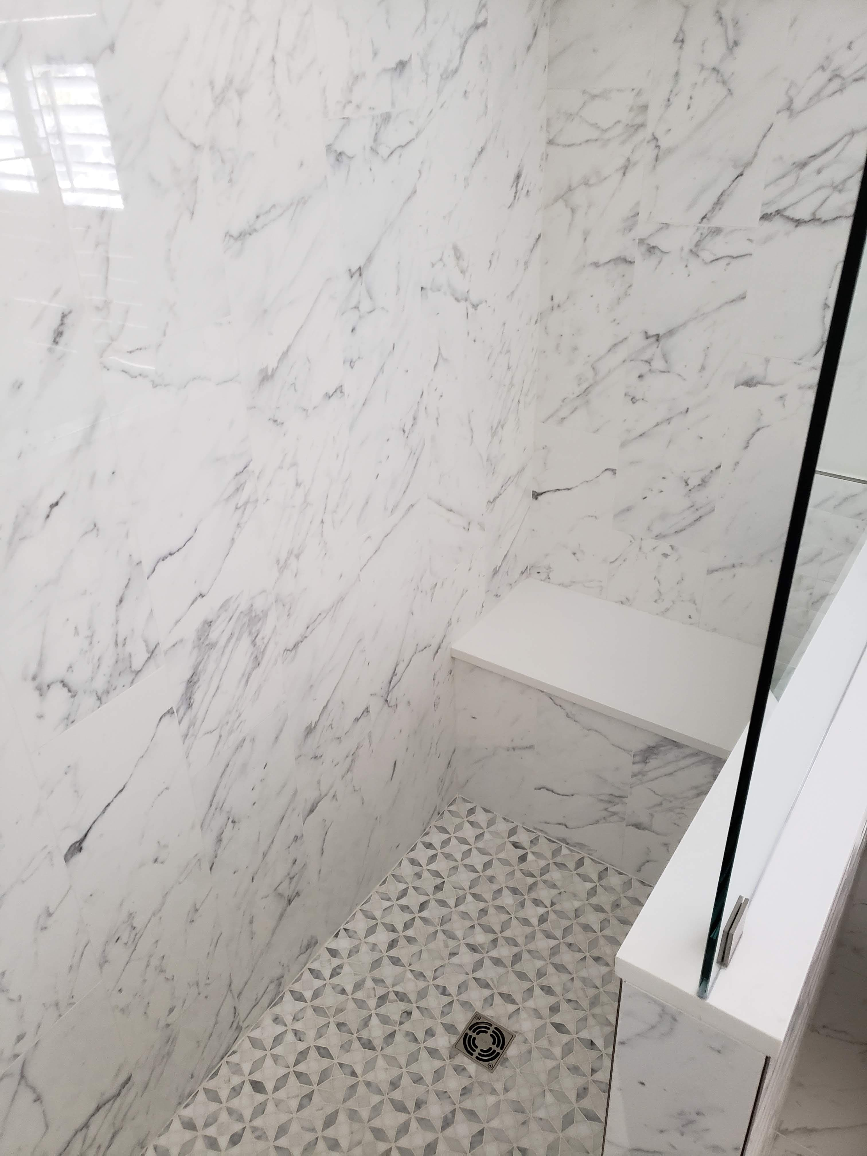 Tile and quartz shower installation with bench