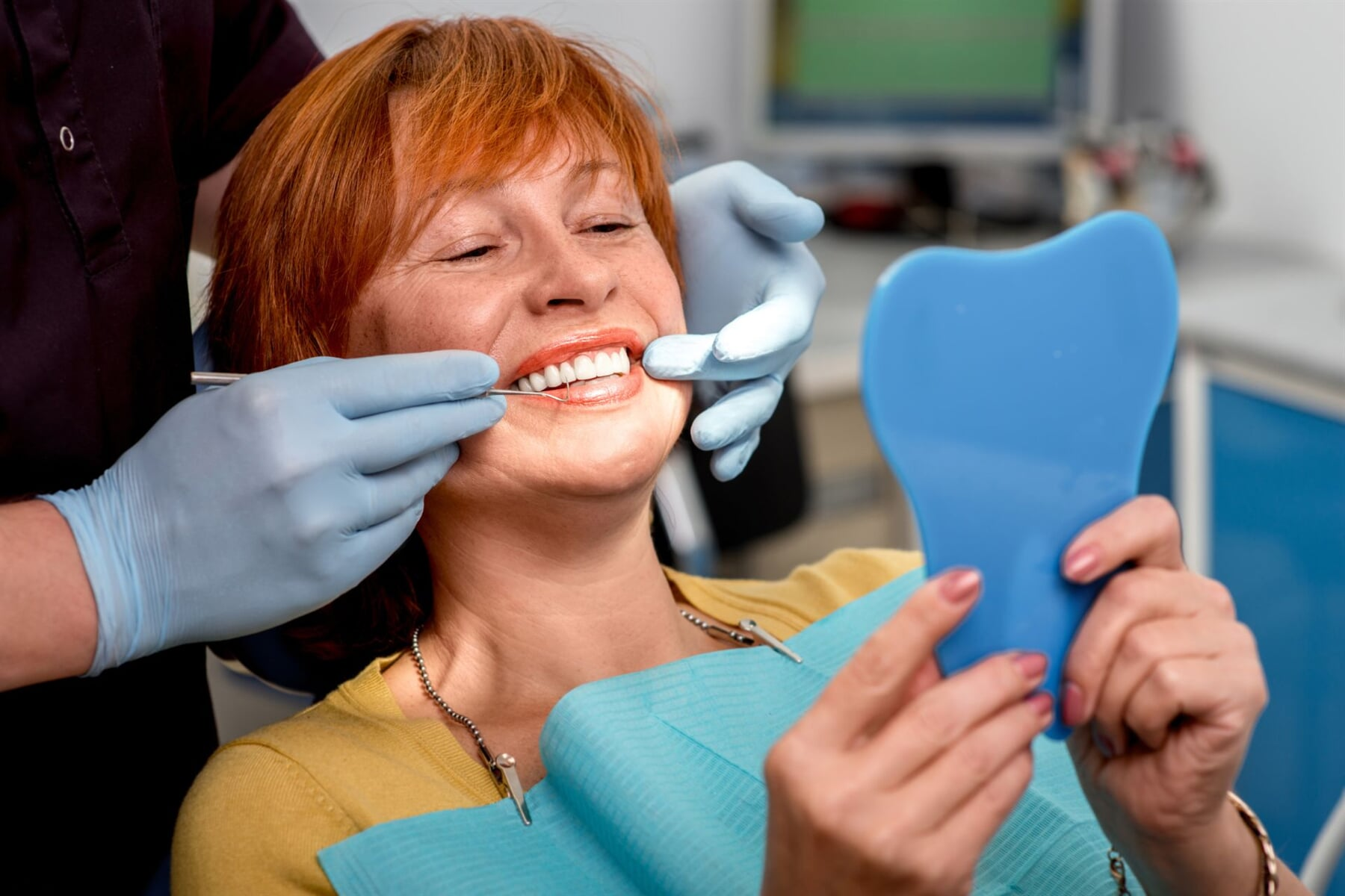 woman getting her teeth examined