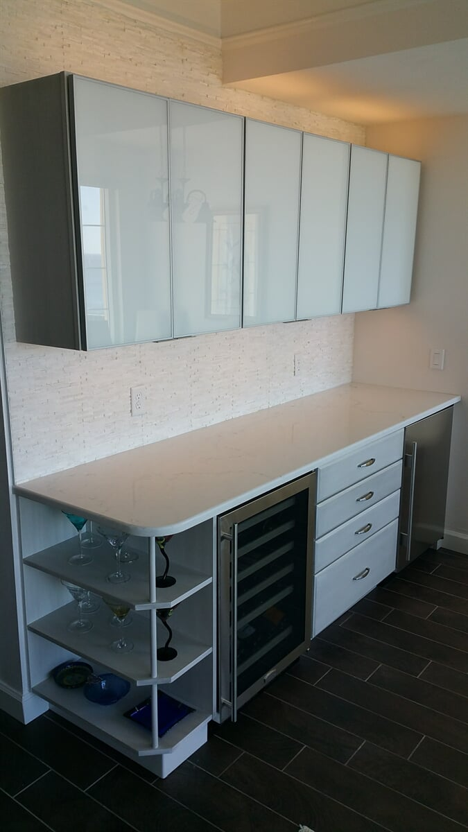 Corner shelf renovation with wine cabinets and bar from Relo Interior Services