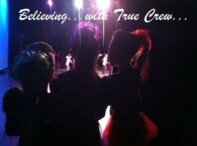 Group of 3 girls waiting to go on stage from behind the curtain at Dance Competition