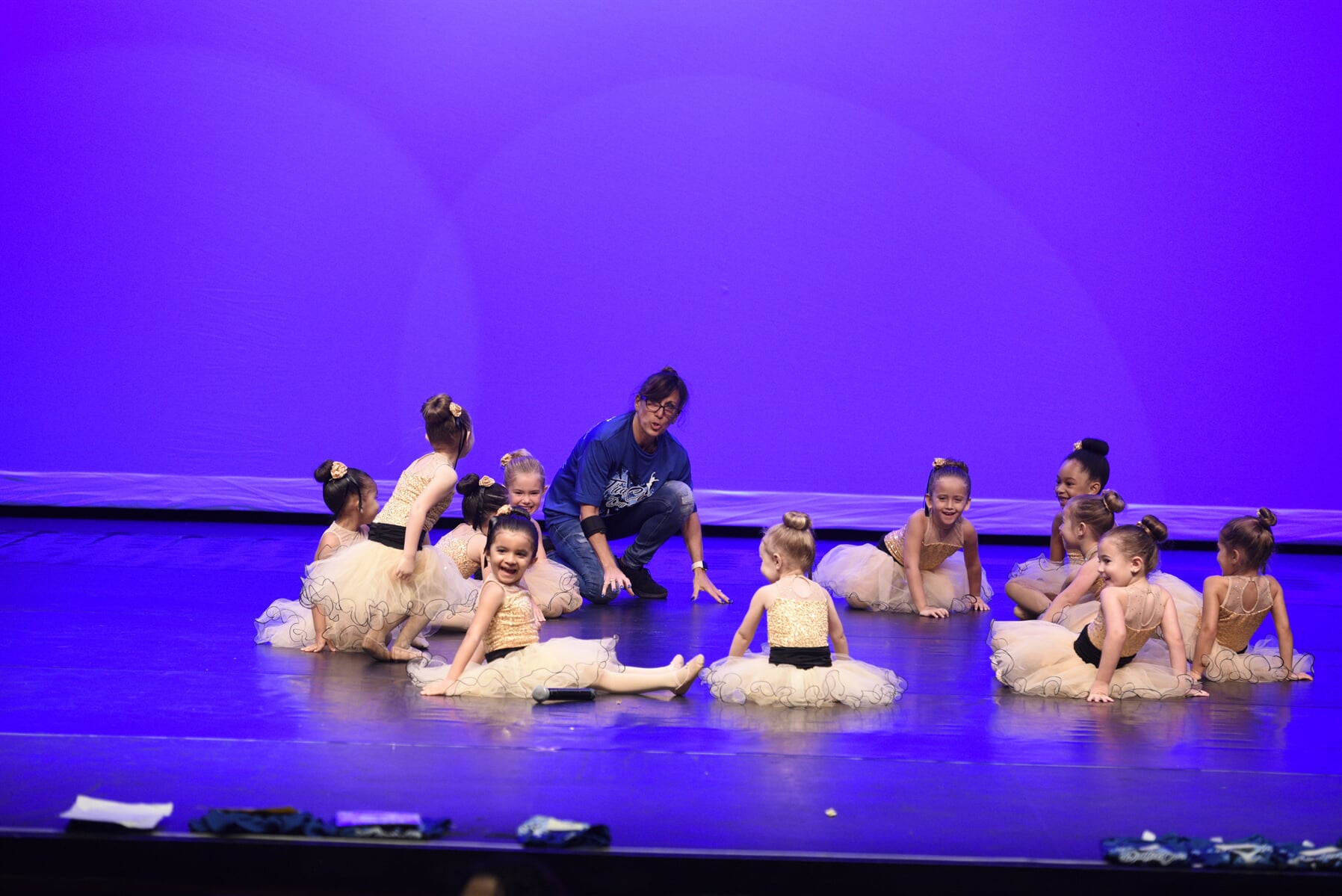 Group of little ballerinas in rehearsal on stage