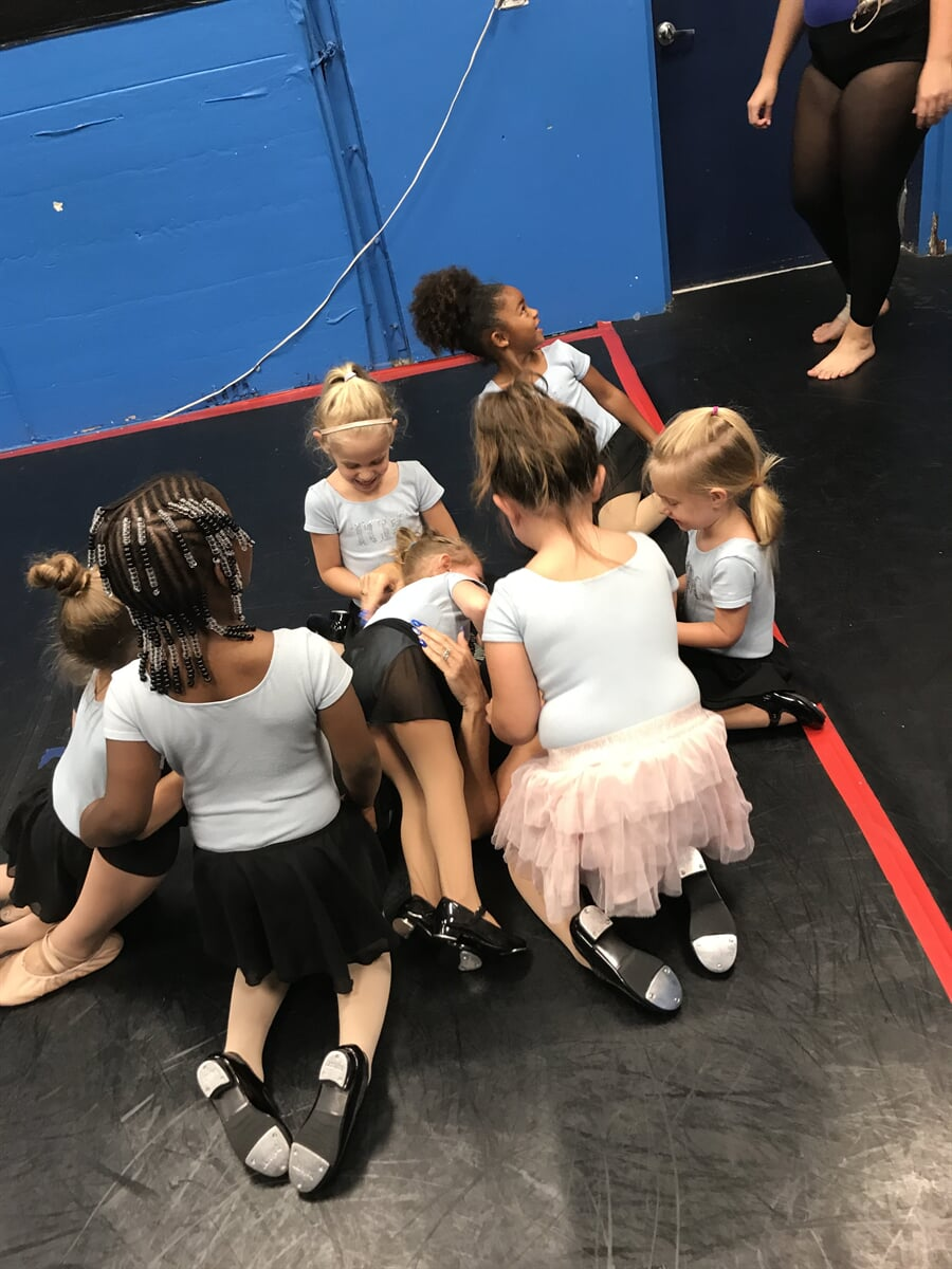 Group of young ballerinas waiting to dance