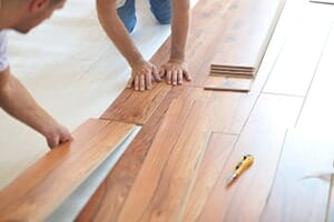 Men Assembling Click Together Wood Flooring