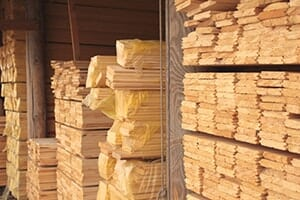 Lumber yard with stacks of plywood and milled lumber