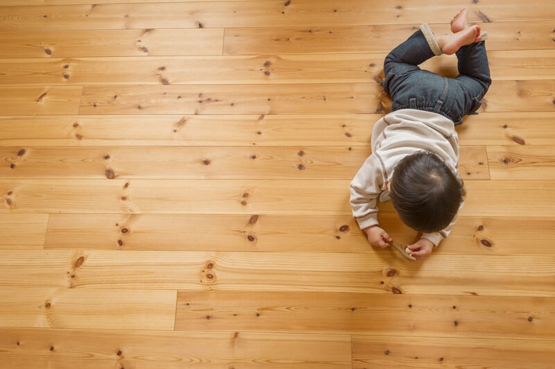 Child playing on wood floor
