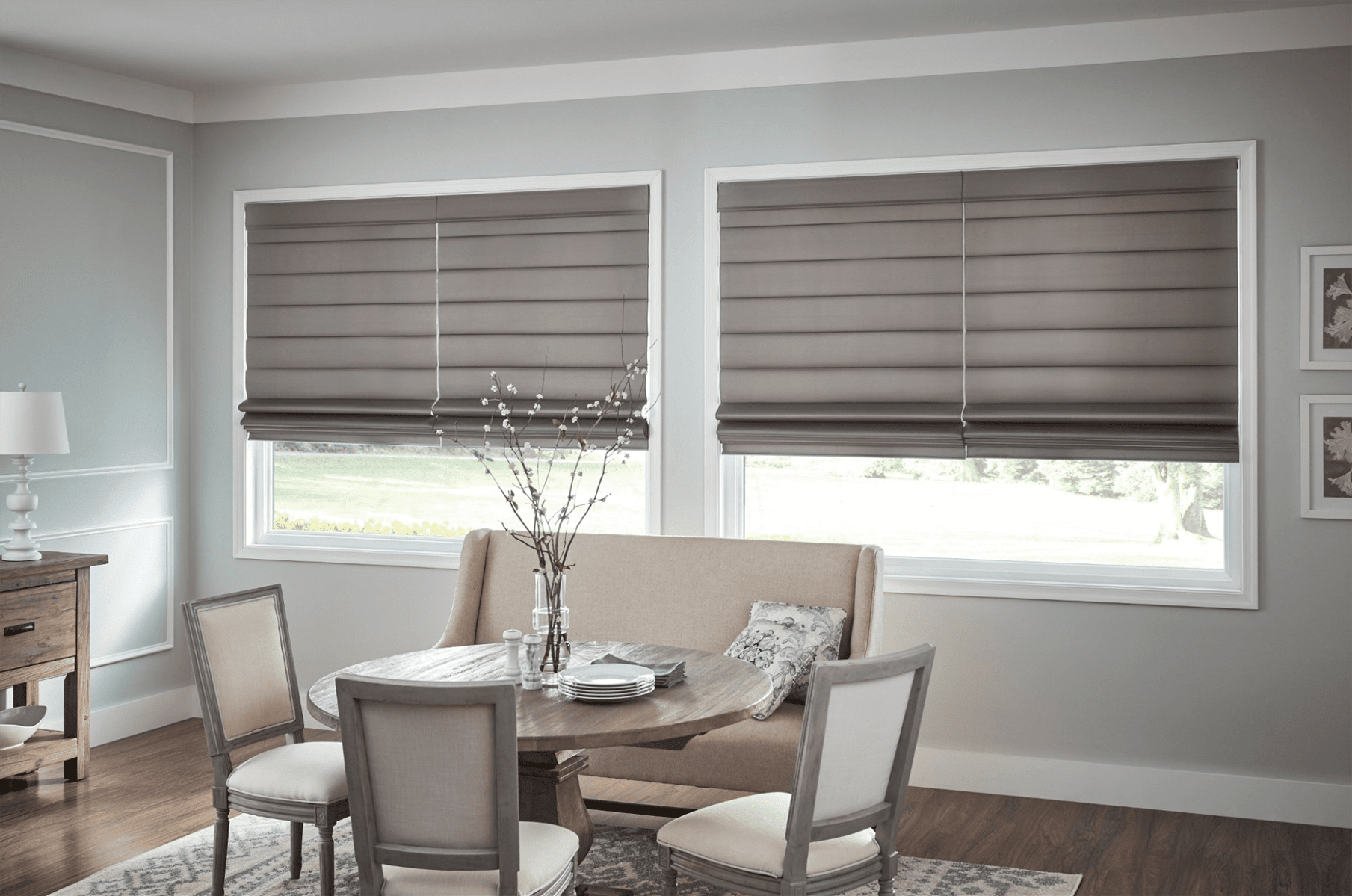 Dining Room showcasing 2 Windows with Shades