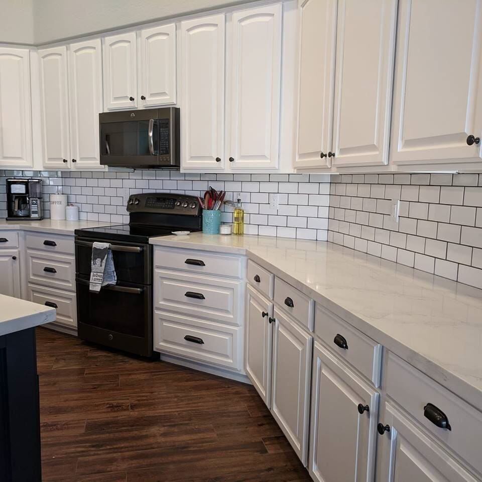 Modern kitchen with subway tile backsplash in Mesa, AZ from The Floor Store
