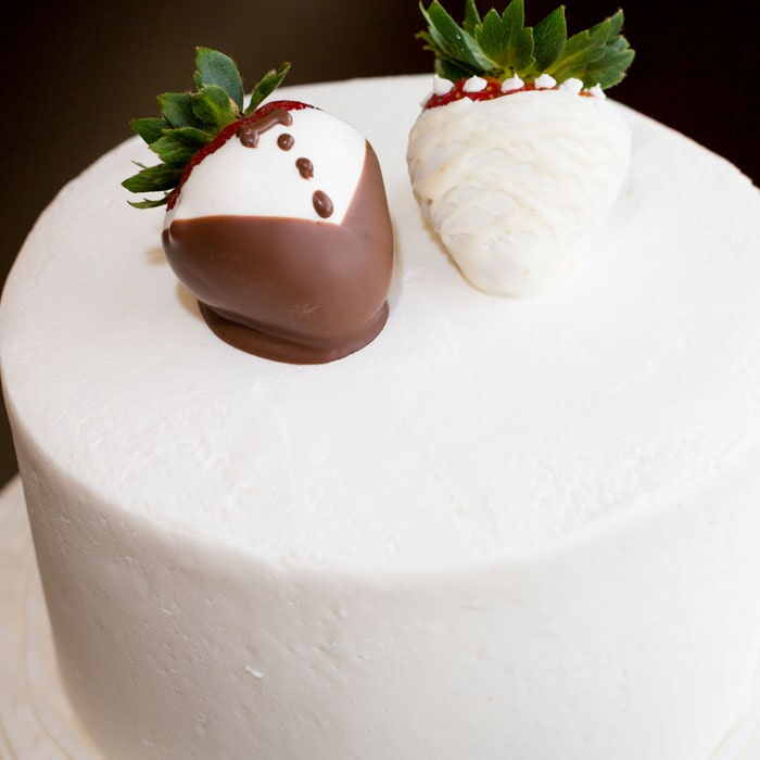 Simple White Wedding Cake with Bride and Groom Chocolate Covered Strawberry topper