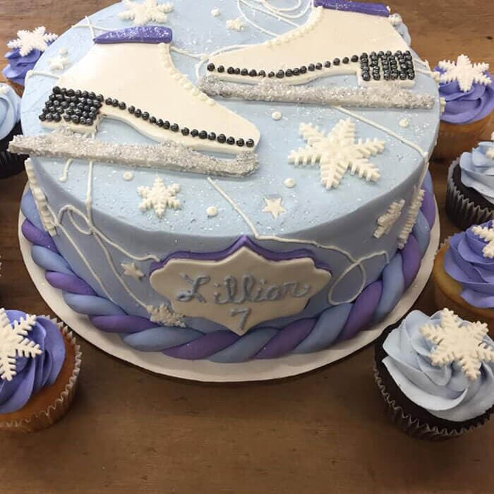 Ice Skating Birthday themed Cake with matching cupcakes