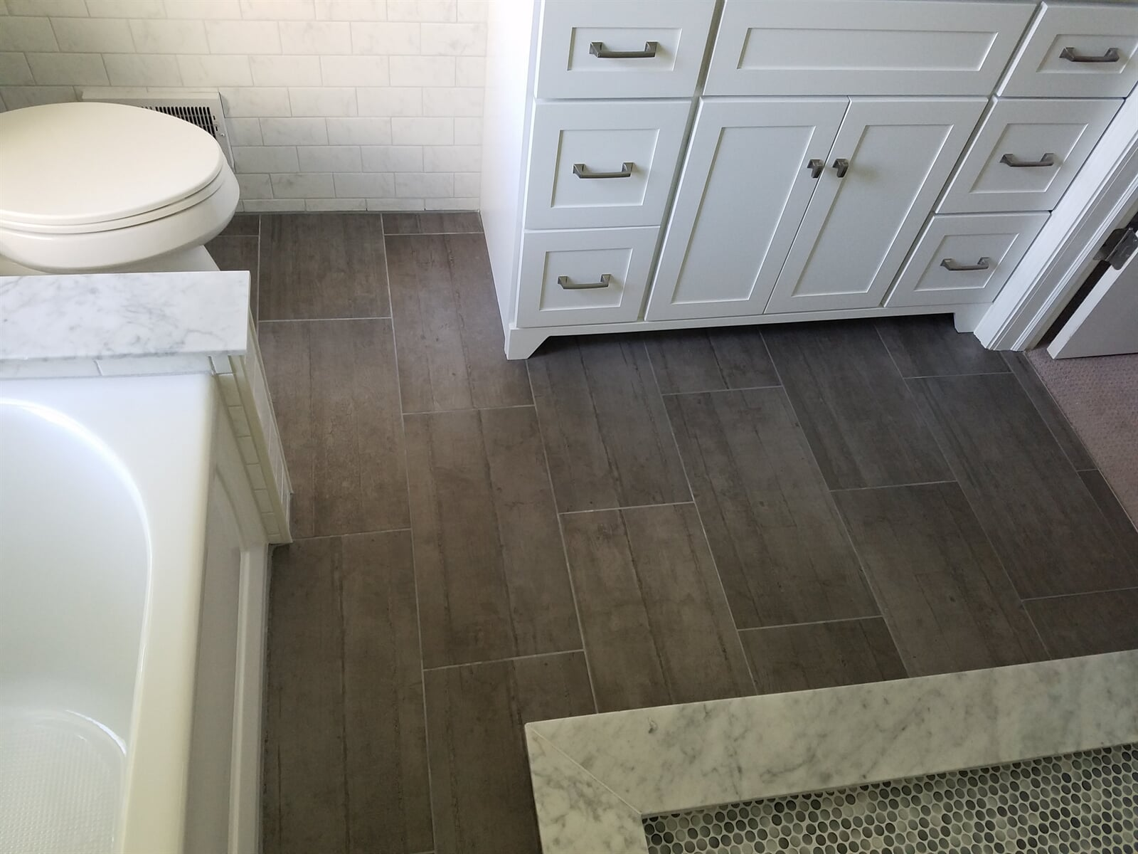 Bathroom Floor Tile installed by RS Home Repair Services