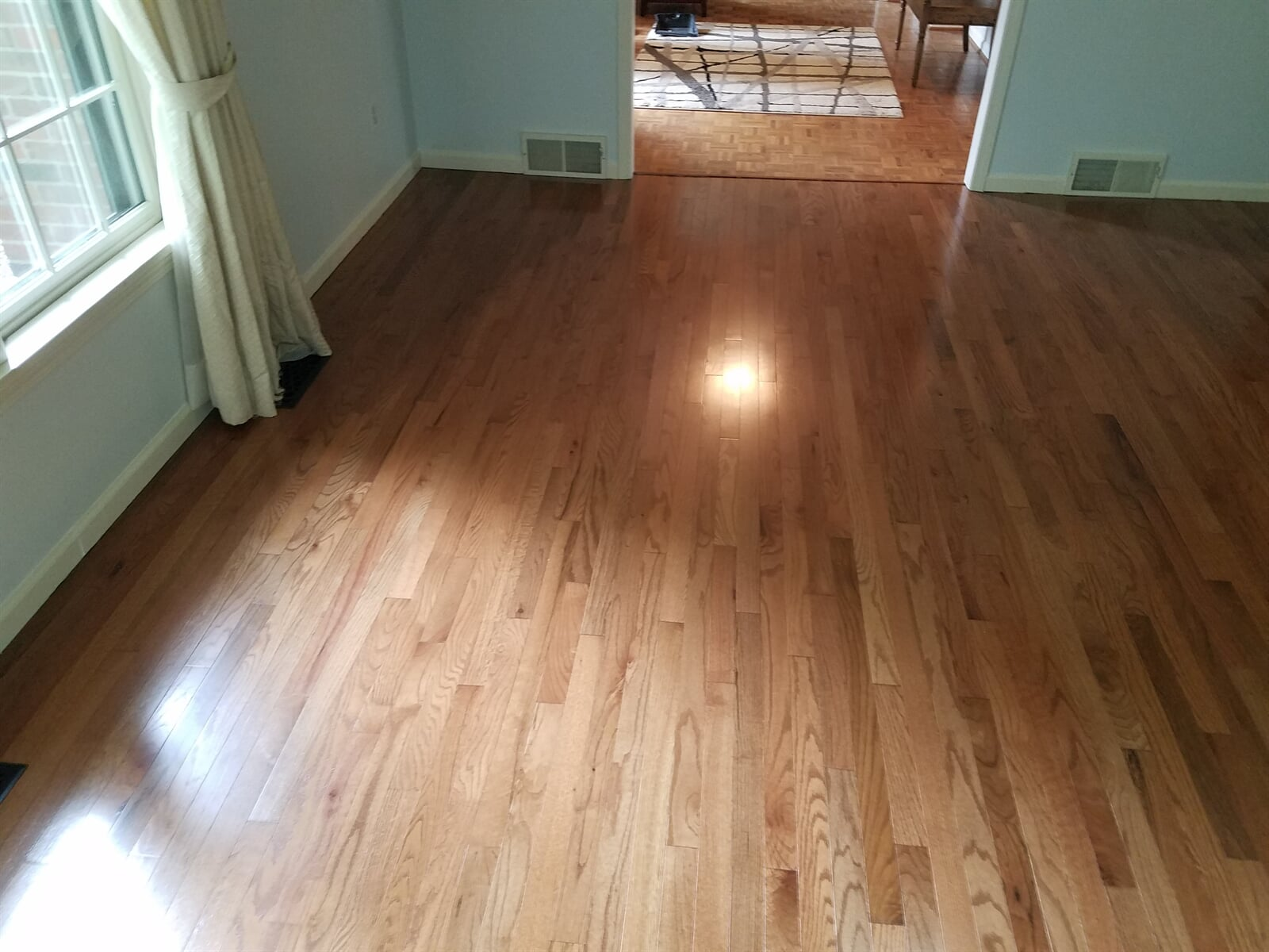 Room in house feature newly installed hardwood flooring