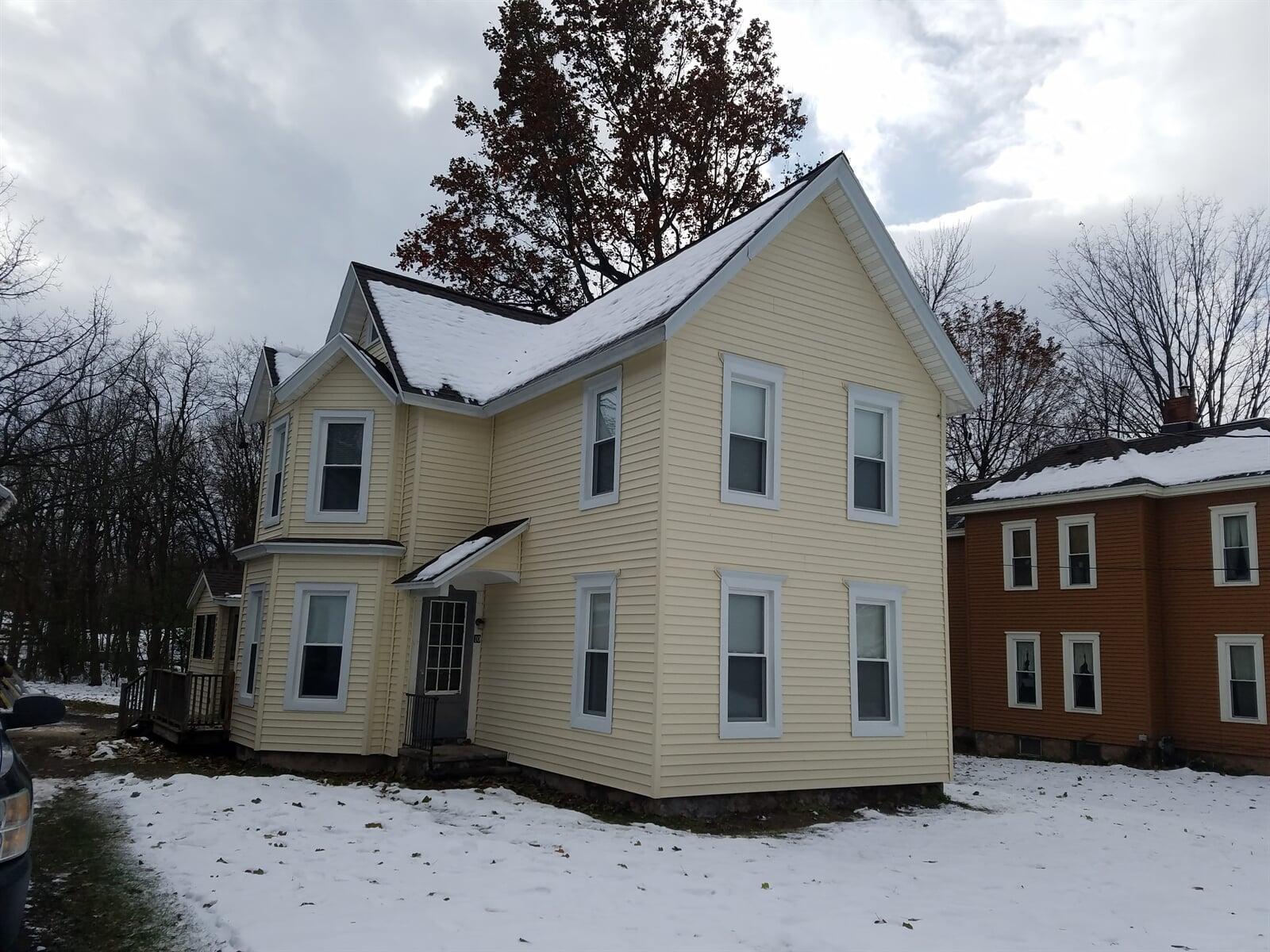 Exterior of Home in Winter Featuring New Windows in House