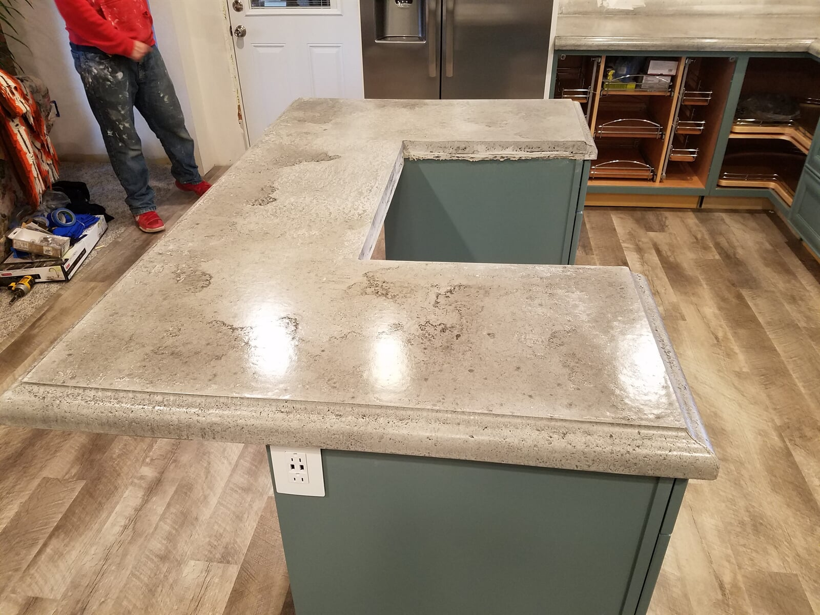 Kitchen Island featuring Concrete Countertops