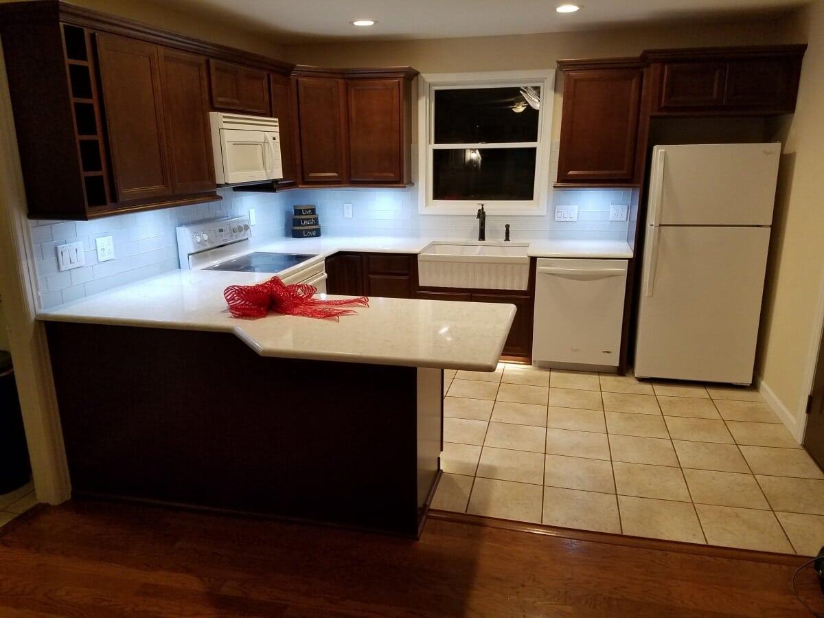 Kitchen remodel featuring under cabinet lighting