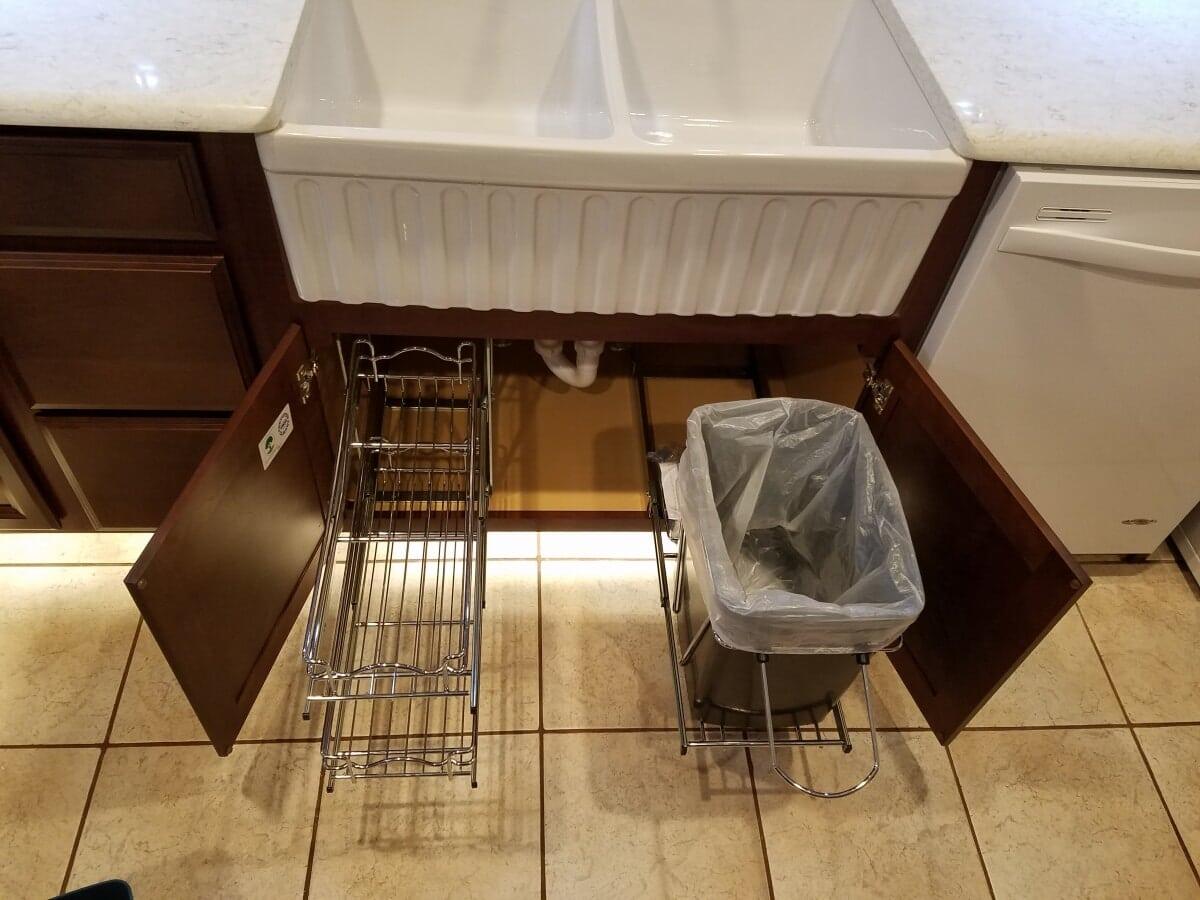 Kitchen Remodel featuring farm sink and under cabinet storage