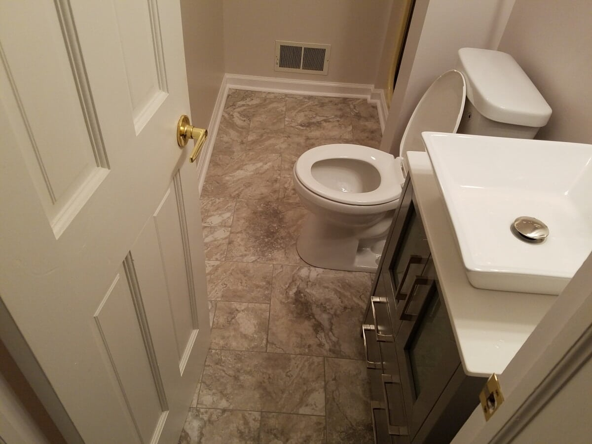 Guest Bathroom featuring New Floor and Sink