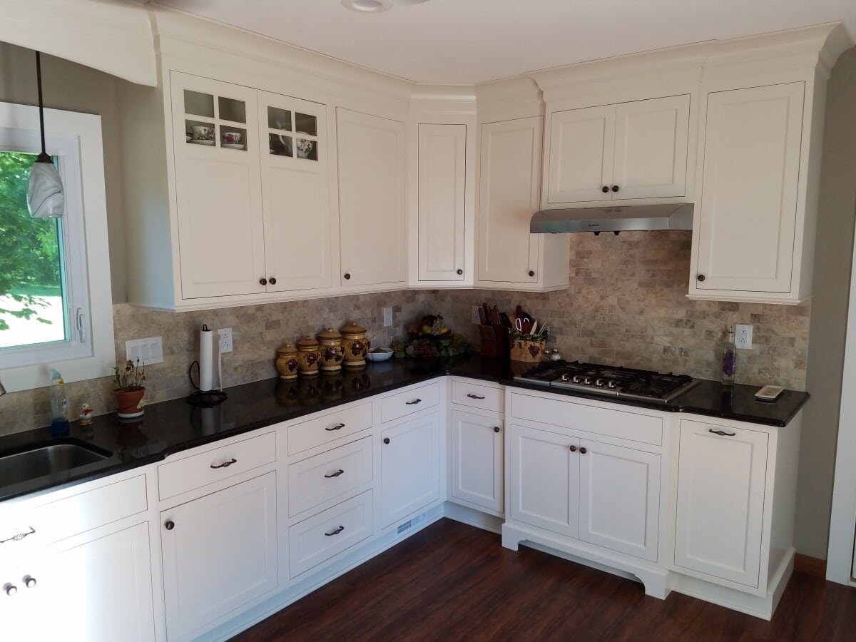 Kitchen Remodel with white cabinets and dark counter tops