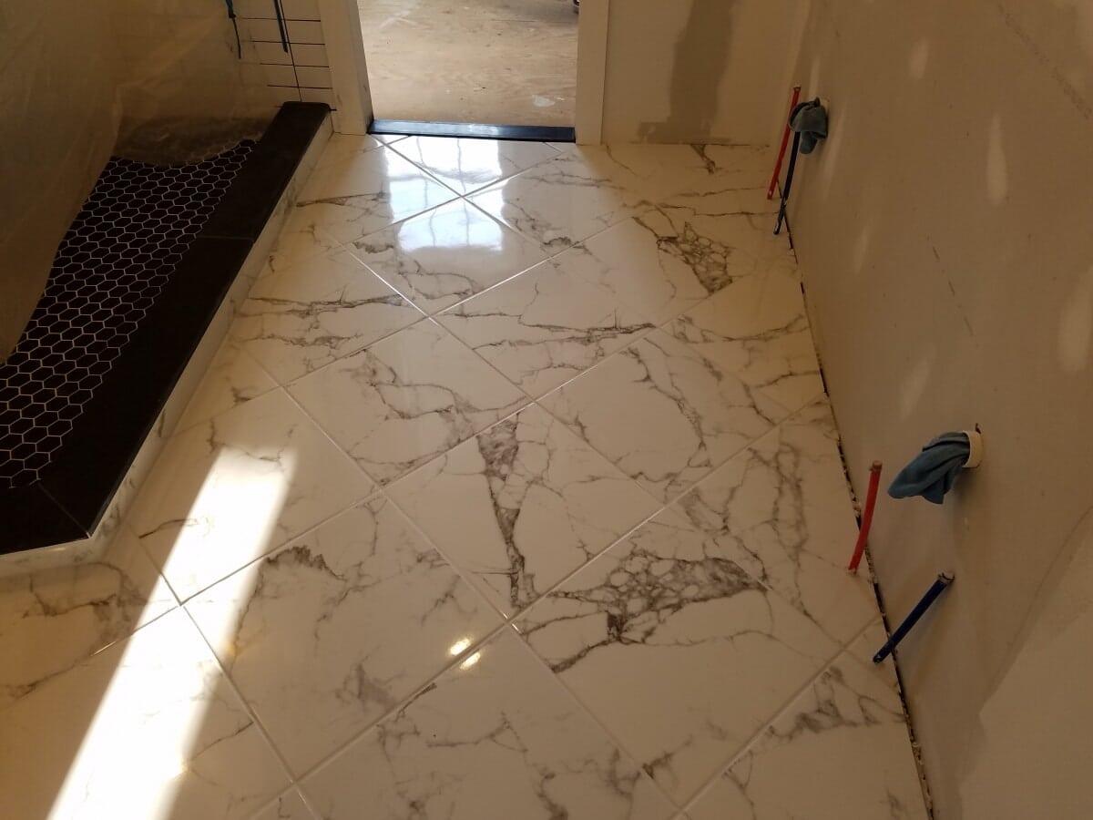 Bathroom Floor, mid re-model with marble tile