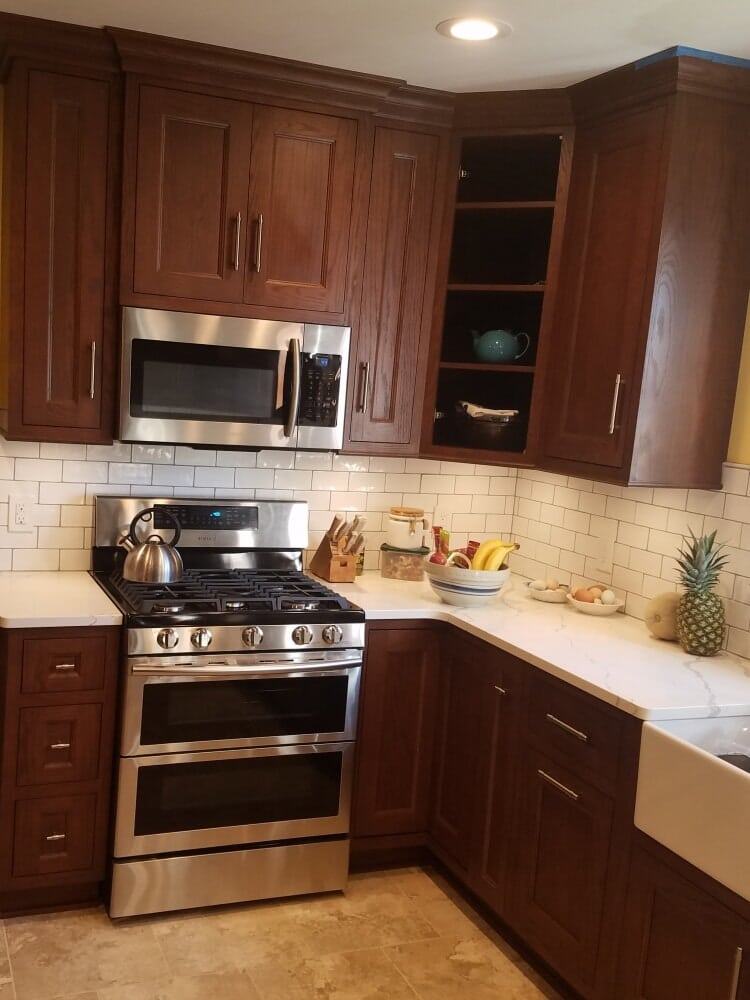 Kitchen Remodel featuring dark brown cabinets and Farm house Sink