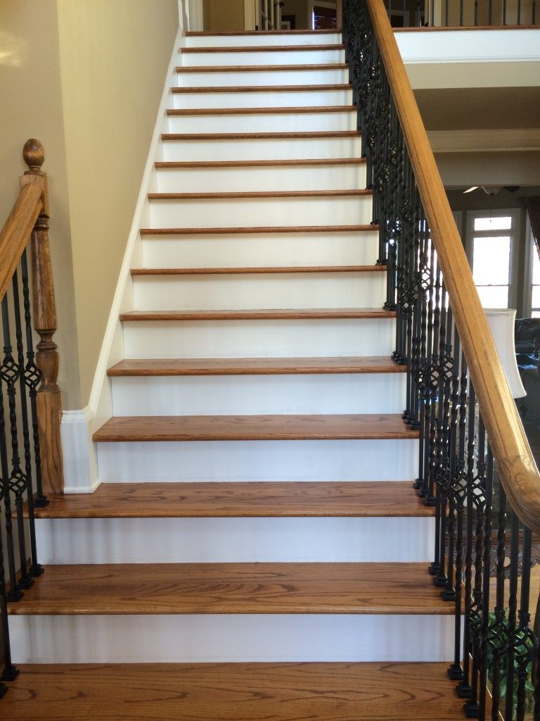 Wood stairs in Cumming, GA from Prestigious Flooring and Design
