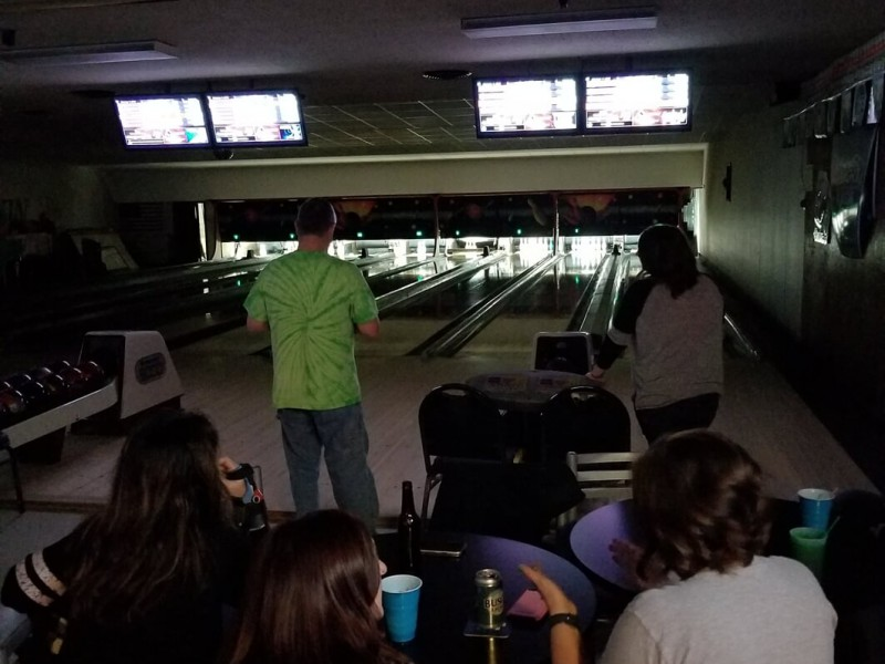 Man bowling in the dark