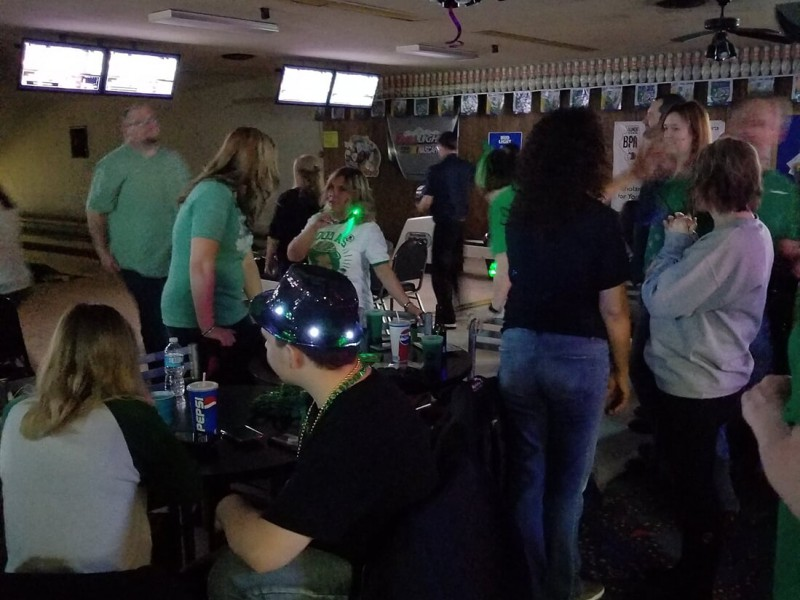 Group of bowlers congregating near lanes