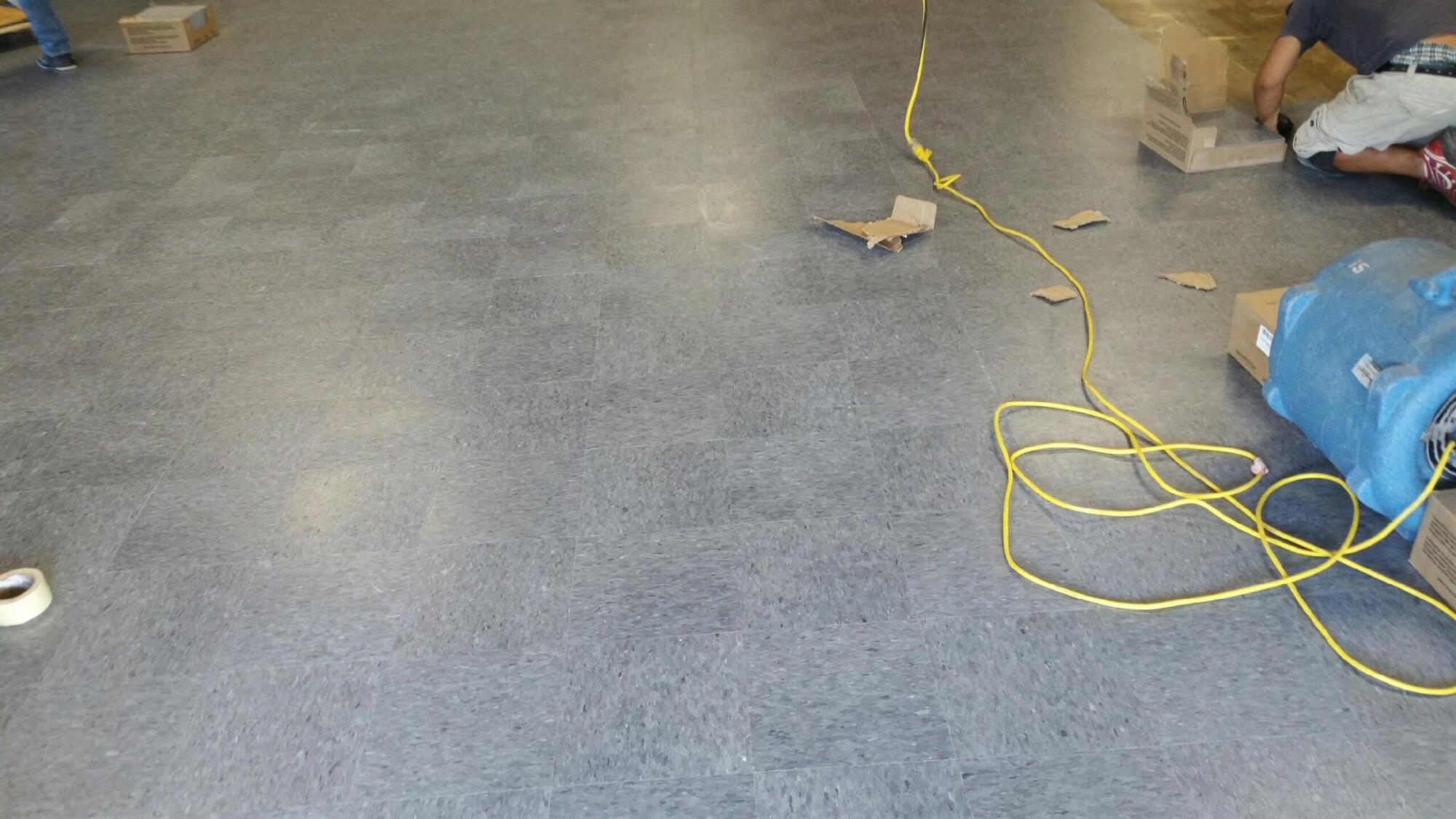Tile flooring installation in progress from Carpets Unlimited