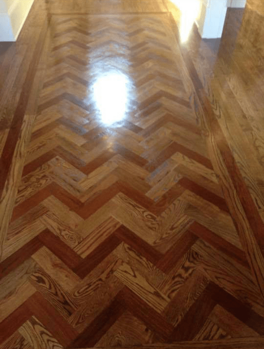 High gloss herringbone hardwood installation in Watkinsville, GA
