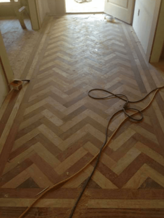 Natural hardwood in herringbone pattern from Carpets Unlimited in Athens, GA