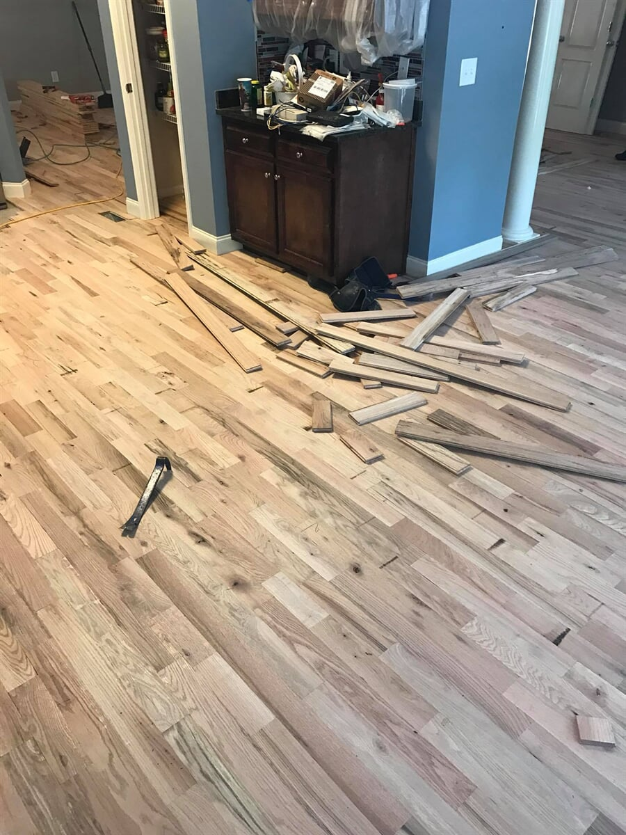 Professional hardwood installation process from Carpets Unlimited